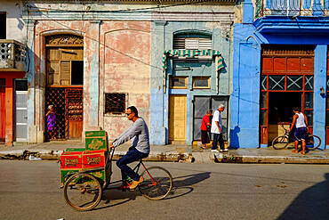 Bicycles and pedestrians on the street, Cardenas, Cuba