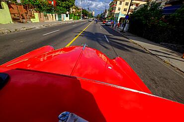 The hood of an antique car driving the streets of Havana, Havana, Cuba