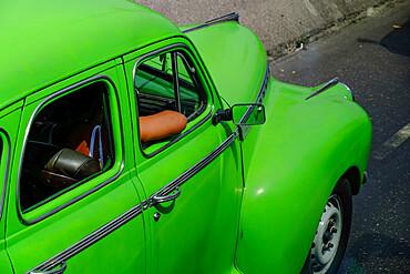 Lime green antique car with passenger's arm through window, Havana, Cuba