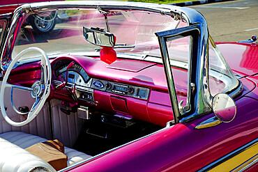 Close view of driver's seat of antique convertable car, Havana, Cuba