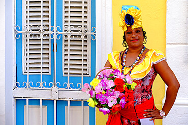 Colorful lady in traditional dress, Old Havana, Cuba, West Indies, Central America