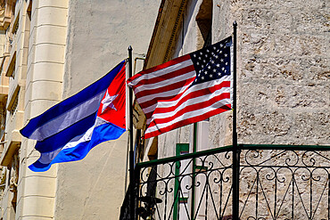 Cuban and American flags waving side by side, Old Havana, Cuba, West Indies, Central America