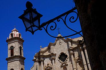 Historic church behind the silhouette of an iron lantern, Old Havana, Cuba, West Indies, Central America