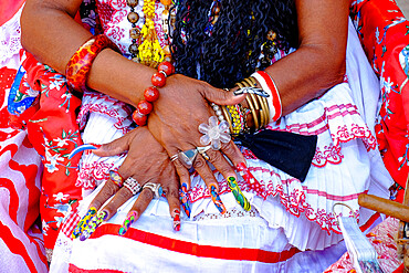 Colorful nails on the crossed hands of a lady in traditional dress, Old Havana, Cuba