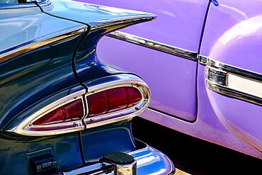 Close view of two colorful antique cars, Havana, Cuba
