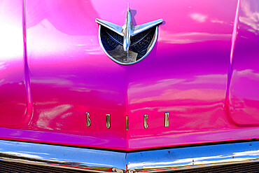Close view of hood ornament and chrome fender on an antique Buick, Havana, Cuba