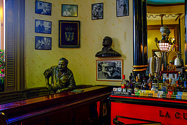 Sculpture of Ernest Hemingway sitting at the bar of the Floridita, Havana, Cuba, West Indies, Central America