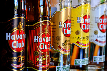 Havana Club bottles lined up at a bar, Cienfuegos, Cuba, West Indies, Central America