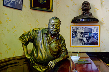 Life-size sculpture of Ernest Hemingway sitting at the bar of the Floridita, Havana, Cuba, West Indies, Central America