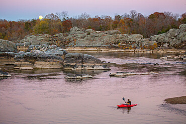 A kid paddles his kayak on the Potomac River at Cabin John, Maryland to watch the rising super moon of November 2016 MR on file