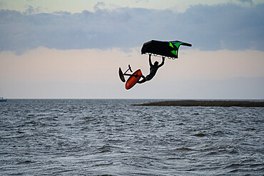 Pro surfer James Jenkins jumps his wing surfer over the Pamlico Sound at Nags Head, North Carolina USA. MR