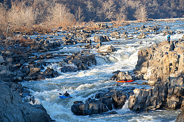 Kayakers thread their way down a series of challenging drops that make up Great Falls of the Potomac River, Virginia USA