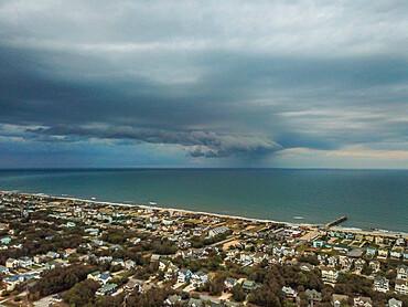 Rain squall moves across the Atlantic Ocean offshore of Nags Head, North Carolina USA