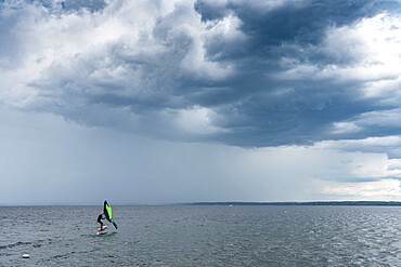 Skip Brown wing surfing into some weather on Sebago Lake, Maine USA. MR