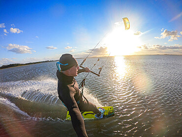 Photographer Skip Brown kiteboards on flat water on the Chesapeake Bay at Hampton, Virginia USA. MR