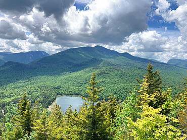 Clouds over High Peaks of the Adirondacks MOuntians and Heart Lake near Lake Placid, new York, USA