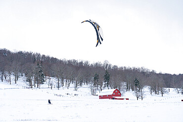Snow kiting a snow covered farm field in Canaan Valley, WV USA