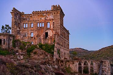 Abandoned building of Termas Radium Spa Hotel Serra da Pena at sunset in Sortelha, Portugal