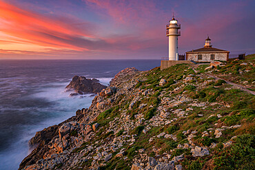 Sea landscape view of Cape Tourinan Lighthouse at sunset with pink clouds, Galicia, Spain - 1346-2