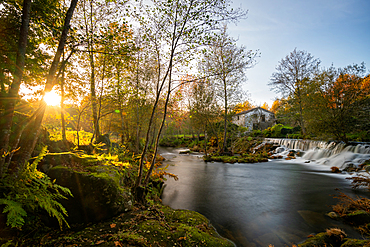 Mondim de Basto waterfall with a mill house at sunset in Portugal