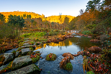 Mestres weir of Piscaredo hiking path on an autumn fall landscape with Cabril river at sunset in Mondim de Basto, Portugal