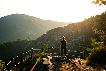 Woman looking at nature mountain landscape from a viewpoint in Mondim de Basto, Portugal