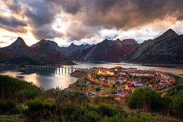 Riano cityscape at sunset with mountain range landscape during Autumn in Picos de Europa national park, Spain