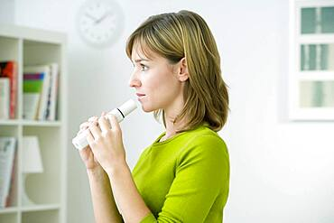 Spirometry consist in measuring the volume and the flow of air that a person is able to inhale and expire. This breath test can be used to detect COPD and asthma. Here the person used a peak flow meter that mesures the peak expiratory flow (which means t
