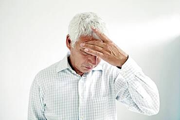 Elderly person with headache