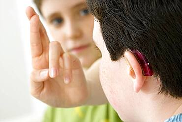 Do not use for HIV. A young boy and his brother using the French sign language to discuss with his hearing-impaired brother. The French sign language uses signs to designate words but also dactylology (each letter of the alphabet is represented by a defined position of the fingers then enabling to spell a word) and the lip reading. The young boy designates the letter \r\ (see image n?0833202 and series of images from n?0572308 to 0573508 to see the other letters of the alphabet).