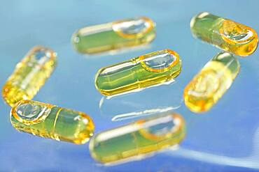 Capsules of cod liver oil. Cod liver oil is consummed mainly for its richness in vitamin A and D, but it also contains omega 3.
