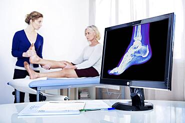 Doctor examining patient's ankle.