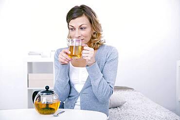 Woman drinking herbal tea.