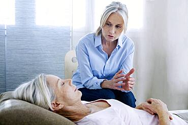 Senior woman undergoing hypnosis session.