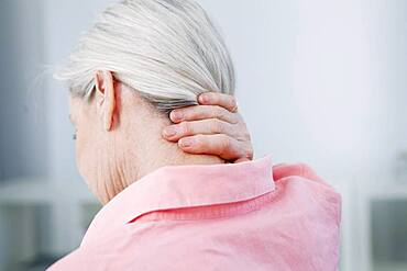 Senior woman with cervical pain.