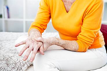 Senior woman with hand pain.