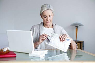 Senior woman receiving medicines bought on internet.