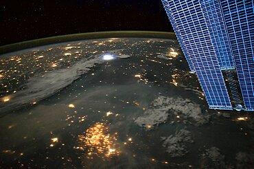 Lightning and city lights, ISS image