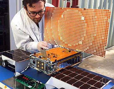 Engineer Tests Solar Array on CubeSat
