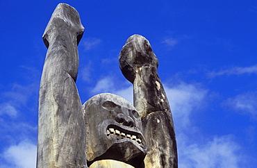 Carved wooden Ki'i (tiki) at 'Ahu'ena Heiau, a restored ancient Hawaiian temple; Kailua-Kona, Island of Hawaii.