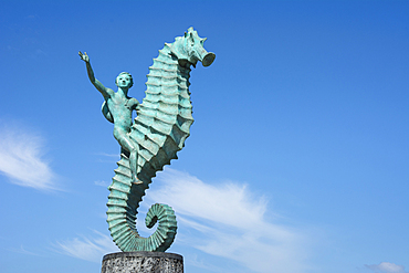 Boy on the Seahorse sculpture by Rafael Zamarripa on the Malecon in Puerto Vallarta, Jalisco, Mexico.