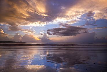 Sunrise on the beach at Magdalena Grand Beach Resort on Tobago Island, Trinidad and Tobago.