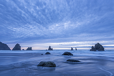 Sea stacks and evening clouds at China Beach, on the Southern Oregon Coast.