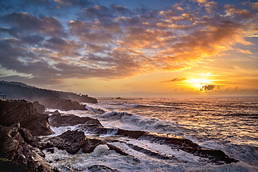 Sunset and storm surf at Shore Acres State Park on the southern Oregon coast.