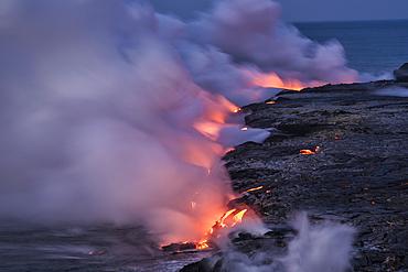 Lava from Pu'u O'o eruption entering the ocean; Hawaii Volcanoes National Park, Island of Hawaii.