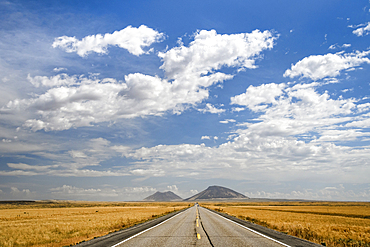 US Highway 20 with Big Butte and East Butte in the distance, eastern Idaho.