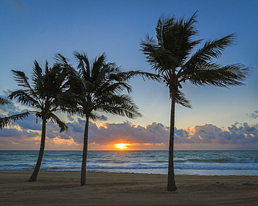 Sunrise on the Caribbean Sea from the beach at Grand Residences Riviera Cancun, Puerto Morelos, Riviera Maya, Mexico.