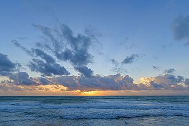 Caribbean Sea sunrise from the beach at Grand Residences Riviera Cancun, Puerto Morelos, Riviera Maya, Mexico.