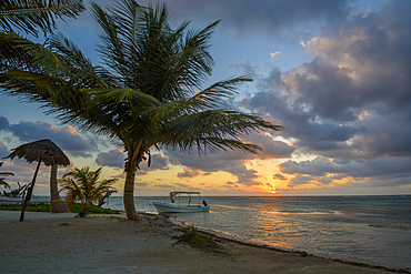 On the playa at sunrise in Mahahual, Costa Maya, Mexico.