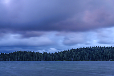 Evening storm clouds over Diamond Lake, Cascade Mountains, Oregon.
